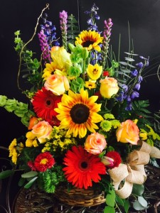 Bright colored mixed floral basket