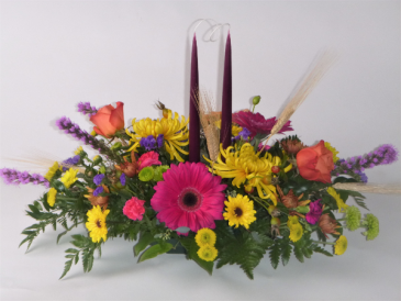 Bright fall centerpiece with tapers Centerpiece