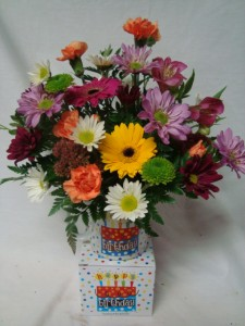 Bright flowers in a keepsake Happy Birthday Mug!