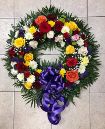 BRIGHTEST REGARDS WREATH SYMPATHY TRIBUTE