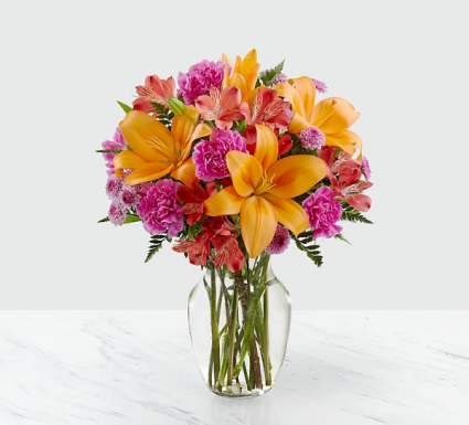 Brilliant & Bright Fresh arrangement in glass vase