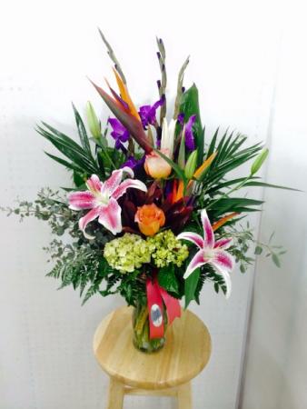 Brilliant Tropical and roses Vase arrangement