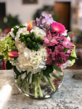 bubble vase with mixed flowers vased