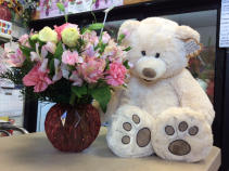 Huggy bear with vase arrangement