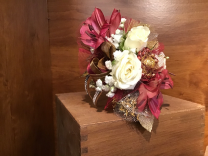 Burgundy and gold corsage
