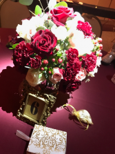 burgundy, blush rose and carnation wedding centerpiece in gold glass vases