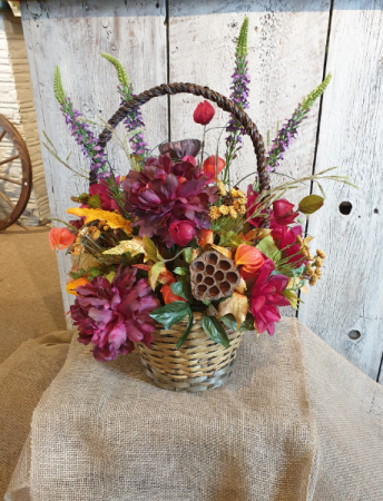 Burgundy Fall in a handled basket  permanent floral