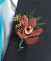 Burgundy Orchid Boutonniere
