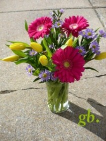 "Bursting Spring Tulips Accented with Gerberas and Wild Daisies 11"" Tall"