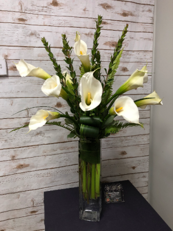 Calla Delight calla lilies with a variety of greens