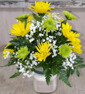 candle with fresh flowers Arrangement