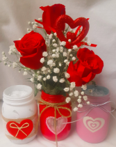 """CANDY HEARTS BOUQUET"" 3 RED ROSES IN A CUTE HEART MASON JAR WITH BABY'S BREATH AND HEART PIC. (WE WILL CHOOSE THE COLOR OF VASE DUE TO LIMITED SUPPLY)"
