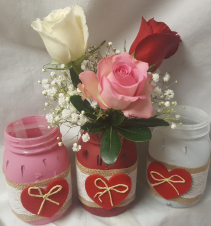 """CANDY HEARTS"" Popular Mason Jar with heart decor decor! 1red, 1 pink and 1 white rose in mason jar."