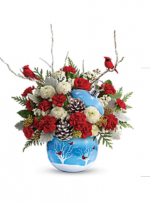 Cardinals in the snow Keepsake filled with fresh flowers