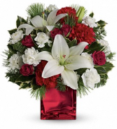 Caroling In The Snow by Teleflora floral arrangement