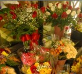 WRAPPED ROSE BOUQUETS $24.99 AND UP Carry out special.
