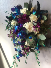 Cascade wedding bouquet. Stunning blue orchards, with purple and ivory accents.