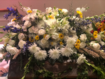 Casket flowers with hint of yellow