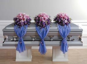 Casket flowers with organza drape Funeral Flowers Casket in Las Vegas, NV | AN OCTOPUS'S GARDEN