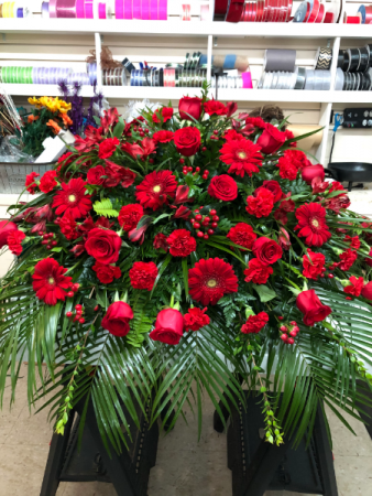 Casket pall mixture of red flowers