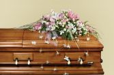 FOREVER IN OUR HEARTS Casket Spray