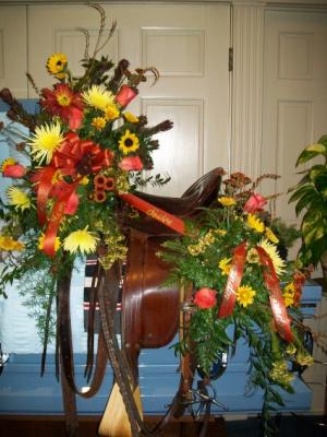 Casket spray on Horse Saddle Sympathy in Greenville, IL | FLORAL DESIGNS BY CINDY