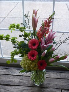 Celebrate! Designed Gerbera Daisies, Lilies, Bells of Ireland,Tulips and Snapdragons