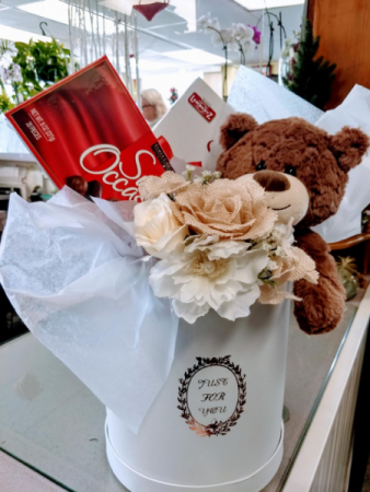 chocolates ,cookies , bear and handtied silk bouqu in a hat box