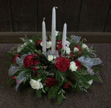 Christmas Centerpiece of Fresh Pine With candles and Christmas flowers