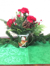 Christmas Mug Arrangement Fresh Evergreens, fresh flowers and Christmas trims