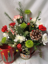 Christmas mug arrangement with red and white  flowers!