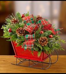 Christmas Sleigh with Fresh Evergreens Arrangement
