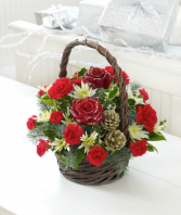 Christmas traditions  Basket of Christmas greens and flowers