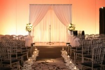 Chuppah with white flowers Ceremony