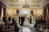 Chuppah with purple flowers Ceremony