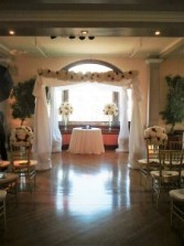 Chuppah with white and red flowers Ceremony