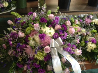 Classic casket spray of pinks, whites and lavender casket spray of pinks, whites, lavenders and purples