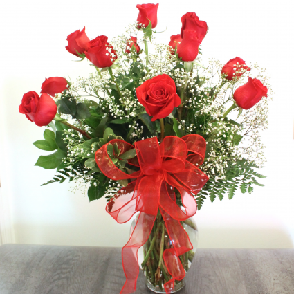 CLASSIC DOZEN LONG STEM ROSES IN A VASE