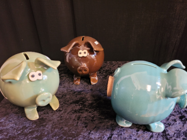 """""""Clay in Motion"""" pottery piggy bank"""