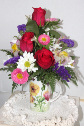 Coffee Cup Arrangement Fresh cut flowers in a coffee cup