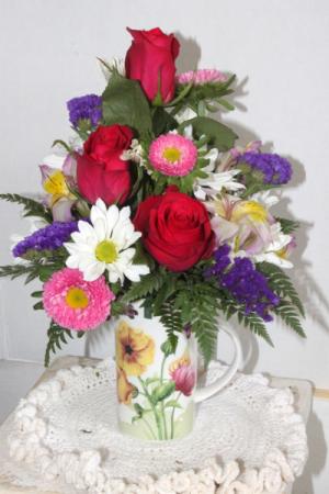Coffee Cup Arrangement Fresh cut flowers in a coffee cup in Penn Yan, NY   Garden of Life Flowers