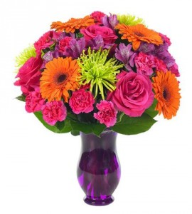 """COLOR EXPLOSION""...Bright flowers in pinks,   orange, purples and lime greens arranged in a vase. (may be clear or a different color vase)"
