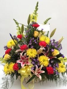Colorful Elegance Wicker Basket Funeral Flowers
