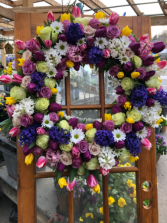 Colorful wreath from Roma Florist Sympathy arrangement from Roma Florist