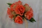 coral blossoms wrist corsage