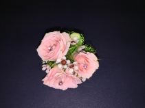 Corsage ring with pink baby roses.