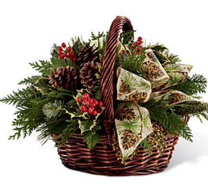 Country Christmas  Basket of greens berries pinecone and bow in Elyria, OH | PUFFER'S FLORAL SHOPPE, INC.