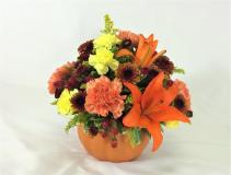country pumpkin fall flowers in ceramic pumpkin