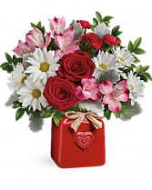 Country sweetheart Sweet as can be! Surprise your sweetheart with this cute, country-style bouquet of red roses and white daisies, delivered in a cheerful ceramic crock with embossed heart and Italian raffia bow.