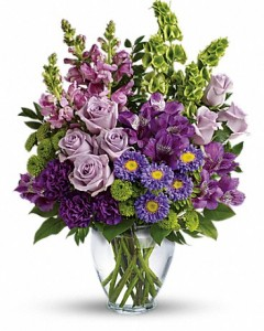 CRAZY IN LOVE   DESIGNER CHOICE OF MEDIUM SIZED MIXED FLORAL ARRANGEMENT IN TALL VASE